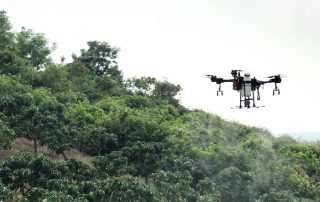 t16 drone crop dusting trees